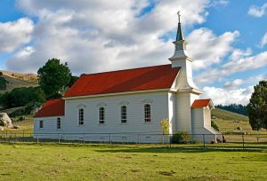 church in the country with red roof and steeple
