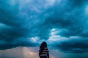 girl watching stormy sky